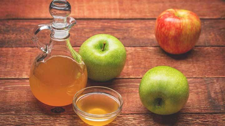 از بین بردن زردی دندان با سرکه سیب